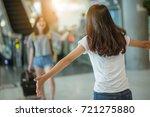 asian girl picking up her... | Shutterstock . vector #721275880