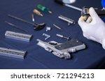 gunsmith cleaning gun pistol...   Shutterstock . vector #721294213