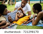 black family enjoying summer... | Shutterstock . vector #721298170