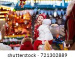 happy little girl in warm...   Shutterstock . vector #721302889