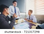 businessmen who are sitting and ... | Shutterstock . vector #721317298