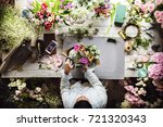 florist making fresh flowers... | Shutterstock . vector #721320343