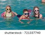 three happy children playing on ... | Shutterstock . vector #721337740