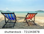 beach chairs on the white sand... | Shutterstock . vector #721343878