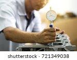 hand mechanic using bore gauge  ...   Shutterstock . vector #721349038