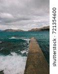 stormy sea. concrete pier on... | Shutterstock . vector #721354600