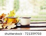autumn composition with hot tea | Shutterstock . vector #721359703