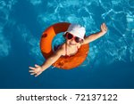 funny little girl swims in a... | Shutterstock . vector #72137122