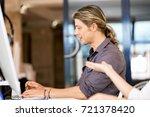 handsome businessman working at ... | Shutterstock . vector #721378420