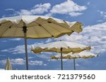 white parasols with blue sky... | Shutterstock . vector #721379560