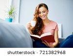 pretty joyful young woman... | Shutterstock . vector #721382968