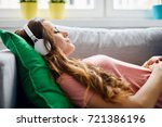 portrait of a beautiful young... | Shutterstock . vector #721386196