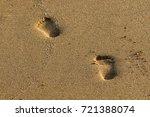 footprints in the sand | Shutterstock . vector #721388074