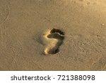footprints in the sand | Shutterstock . vector #721388098