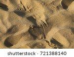 footprints in the sand | Shutterstock . vector #721388140