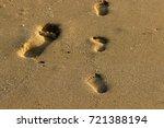 footprints in the sand | Shutterstock . vector #721388194