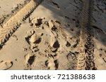 footprints in the sand | Shutterstock . vector #721388638