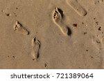 footprints in the sand | Shutterstock . vector #721389064