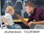 cute little boy at speech... | Shutterstock . vector #721393849