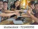 friends making a pile of hands ... | Shutterstock . vector #721400950