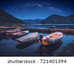 boats in a boka kotor bay under ... | Shutterstock . vector #721401394