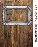 old picture frame on wood... | Shutterstock . vector #721404934