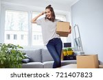 happy young woman holding box... | Shutterstock . vector #721407823