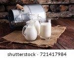 a jug of milk and glass of milk ... | Shutterstock . vector #721417984