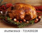 tasty roasted turkey on plate   Shutterstock . vector #721420228