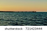 jetty near bundegi beach ... | Shutterstock . vector #721423444