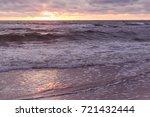 sunset on the beach. baltik sea  | Shutterstock . vector #721432444