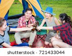 Small photo of group of adventure tourist camping cheerful and enjoy together by take up bottle beer in friendly, Barbecue camping near the lake meadow in background