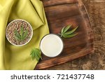 glass of hemp milk and bowl... | Shutterstock . vector #721437748
