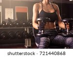 sporty woman sitting at gym... | Shutterstock . vector #721440868