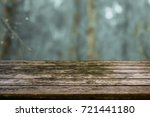 rustic wood table in front of a ... | Shutterstock . vector #721441180