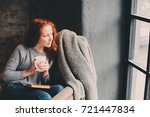 happy redhead woman relaxing at ... | Shutterstock . vector #721447834
