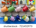 colorful empty cups hanging on... | Shutterstock . vector #721452973