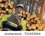 forestry worker with digital...