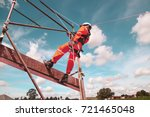 workers up high with safety... | Shutterstock . vector #721465048