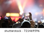 fans who take photos and record ...   Shutterstock . vector #721469596