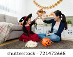 Small photo of beauty girl and her mother celebrate she obtain many sweet candies from Halloween play game