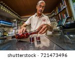 Small photo of LISBON, PORTUGAL - 25 JUNE 2017: man pouring in the glass in the Ginjinha Registada, the oldest and most famous establishment in Lisbon dedicated to sell Ginjinha, a type of Sour Cherry Brandy