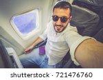 handsome man travel take photo... | Shutterstock . vector #721476760