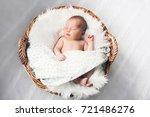 sleeping newborn baby in a wrap ... | Shutterstock . vector #721486276