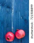 red ripe pomegranates on blue... | Shutterstock . vector #721508899