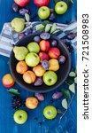 mixed fruits on a wooden... | Shutterstock . vector #721508983