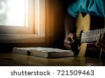 young man is playing guitar and ... | Shutterstock . vector #721509463
