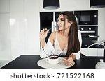 pretty brunette girl is eating...   Shutterstock . vector #721522168