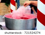 hand rolling cotton candy in... | Shutterstock . vector #721524274