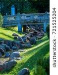 bridge in park | Shutterstock . vector #721525204